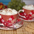 Two cups of cappuccino with cream — Stock Photo