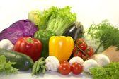 Bright fresh vegetables on white background — Stock Photo