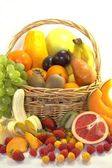 Fresh colorful fruits and berries in the basket — Stock Photo