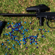 Paintball marker and pod with paintballs — Stock Photo #10731043
