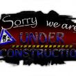 Stock Photo: Sorry we are under construction dark red