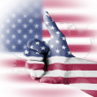 Thumb up with digitally body-painted USflag — Stock Photo #9546492
