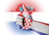 Thumb up with digitally body-painted Croatia flag — Stock Photo