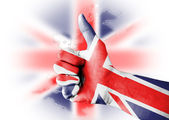Thumb up with digitally body-painted UK flag — Stock Photo