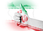 Thumb up with digitally body-painted Iran flag — Stock Photo