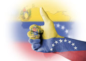 Thumb up with digitally body-painted Venezuela flag — Stock Photo