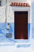 Brown door and electric meter — Stock Photo