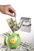 Piggy bank and a house — Stock Photo