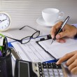 Stock Photo: Calculating and noting