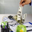Piggy bank on a desk — Stock Photo #9155045