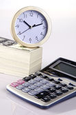 Money, calculator and clock — Stock Photo