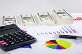 Money, bar chart and calculator — Stock Photo