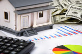 Model house, calculator, business chart and dollars — Stock Photo