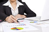 A business woman pointing a bar chart — Stock Photo