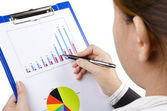 A business woman looking at bar chart — Stock Photo
