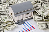 Model house, dollars and business chart — Stock Photo