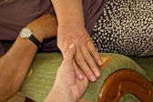 Adult helping senior in home — Stock Photo