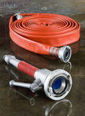 Firehose and nozzle — Stock Photo