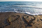 Hearts on beach — Stock Photo