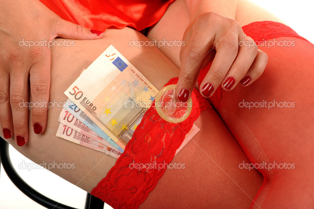 Safe sex for money with an attractive prostitute  Stock Photo #9238911