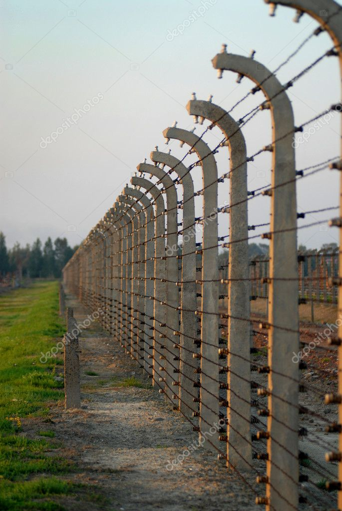 The fence with wire in Auschwitz Birkenau — Stock Photo #9243676