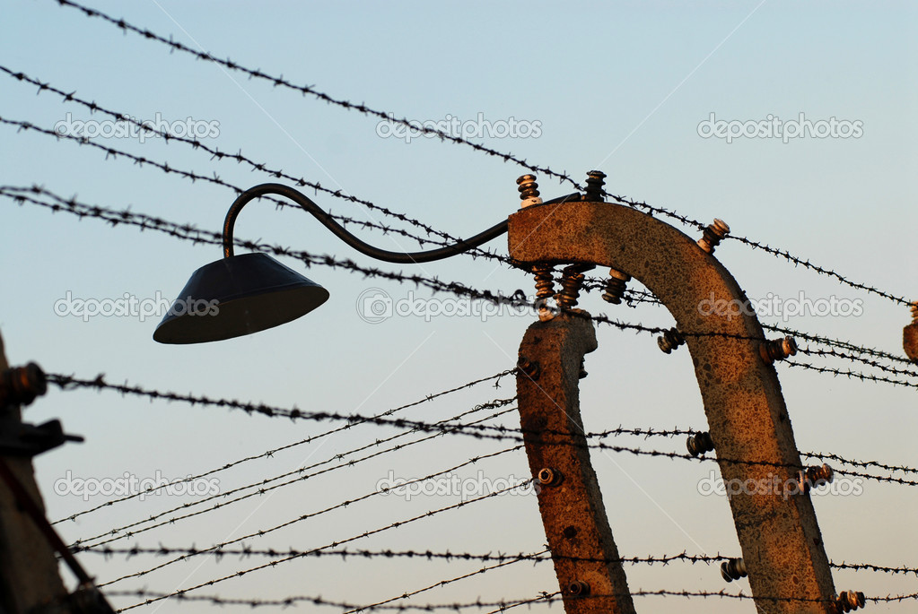Fence, wire and a lamp in Auschwitz Birkenau — Stock Photo #9243683