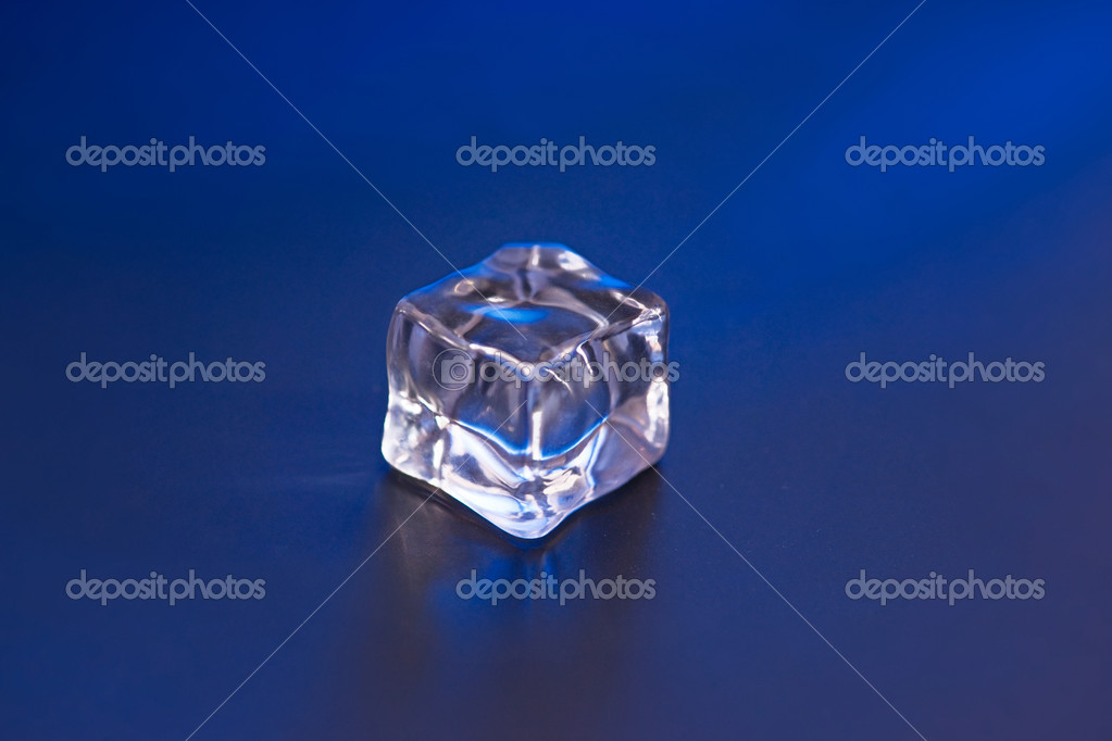 An ice cube on the blue background — Stock Photo #9626299
