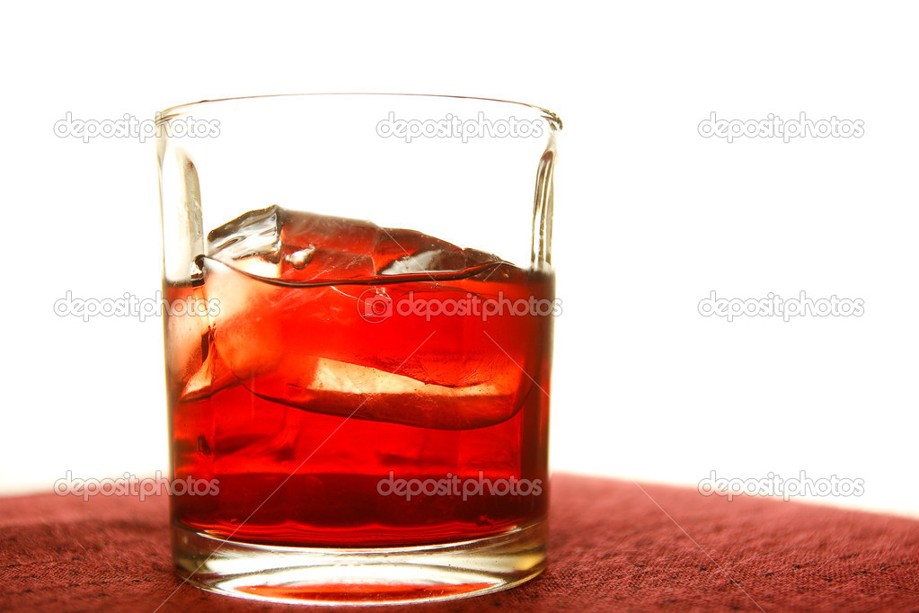 Whiskey in glass with ice cubes — Stock Photo #10126547