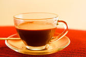 Cup of coffee on the table in red. — Stock Photo