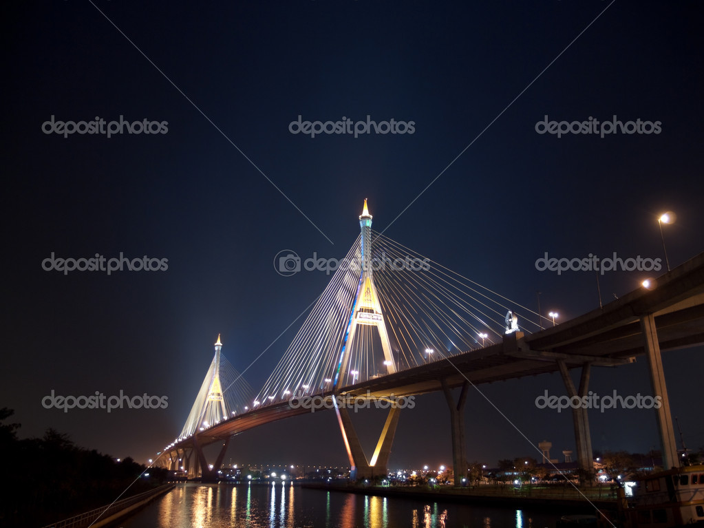 Bhumibol Bridge also casually call as Industrial Ring Road Bridge illuminate with spotlight at night scene, Samut Prakarn,Thailand — Stock Photo #10395151