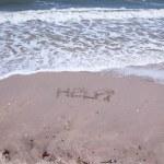 Help Sign on the beach — Stock Photo