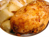 Roast chicken with spices and fried potatoes — Stock Photo
