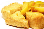 Roast pork and fried potatoes — Stock Photo