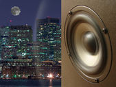 Acoustic system and sound wave against a city — Stock Photo