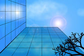 Modern building against the sky and cloud reflection in its wind — Stock Photo