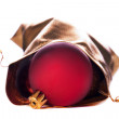 Royalty-Free Stock Photo: Gold bag with red Christmas balls