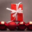 Present and christmas balls — Stock Photo #10108650