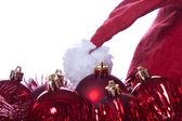 Balls, bands and Santa Claus hat — Stock Photo