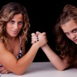 Mother and daughter wrestling, isolated on black, studio shot — Stock Photo