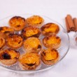 Pasteis de nata on a plate - traditional portuguese egg tarts - pastries — Stock Photo