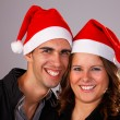 Happy christmas young couple, studio shot. — Stock Photo