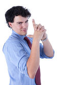 Young businessman with hand as an police officer with weapon raised, isolated on white, studio shot — Stock Photo