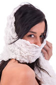 Beautiful woman covering her face with a white handkerchief, isoated on white, studio shot — Stock Photo