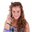 Beautiful girl on the phone smiling, isolated on white background. Studio shot. — Stock Photo