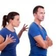 Woman arguing with a man, isolated on white, studio shot — Stock Photo