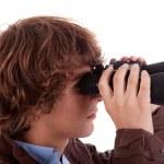 Young boy looking through binoculars, isolated on white, studio shot — Stock Photo #9896965