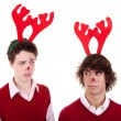 Happy young men wearing reindeer horns, admired, on white, studio shot — Stock Photo