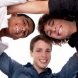 Three young man of different colors,looking to camera and smiling, view from below — Stock Photo #9897407