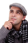 Portrait of a young man thinking, in autumn and winter clothes, isolated on white. Studio shot — Stock Photo
