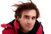 Portrait of a young man with hair on the wind , in autumn and winter clothes, isolated on white. Studio shot — Stock Photo